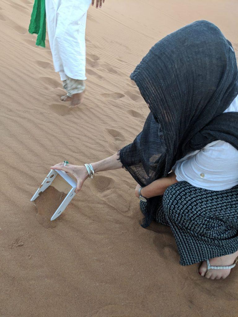 Linda playing with a sandfish