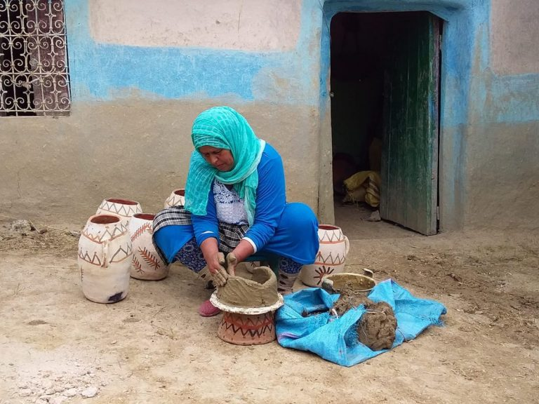 pottery woman 2 son fb